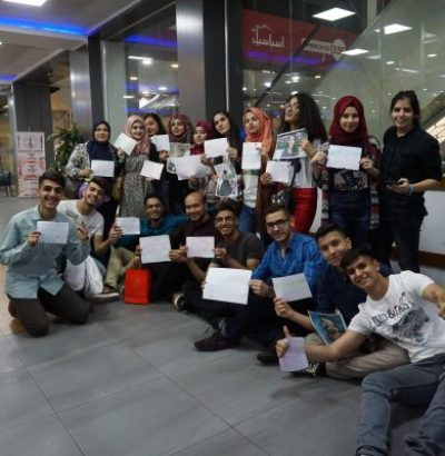 Students showing their completion certificates.