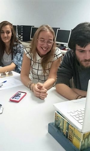 Students and a teacher at the American University of Technology in Lebanon interacting with students in New York through their laptop.