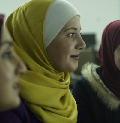 three female students working