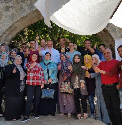 group of participants and facilitators posing